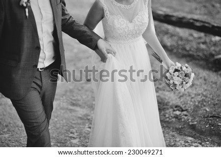 Beautiful newlyweds together forever and never  apart. - stock photo