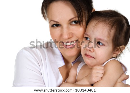 Beautiful nice nurse holding a baby girl on a white background