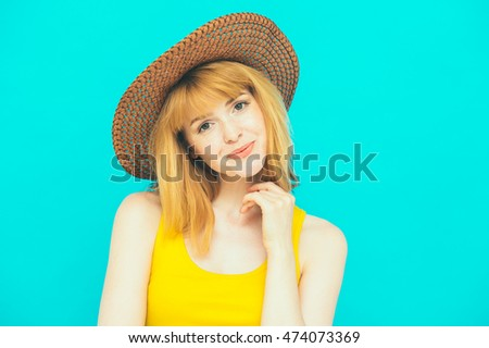 Beautiful nice woman in hat  on color trendy green mint background portrait