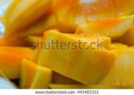 Beautiful nicely cut yellow delicious mango on the plate