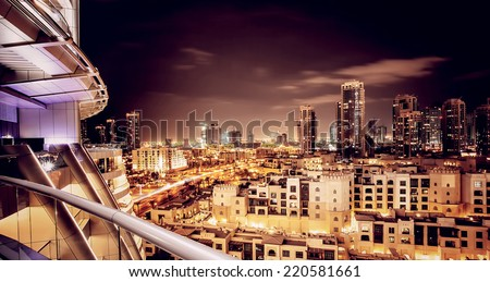 Beautiful night cityscape, Dubai, United Arab Emirates, modern futuristic buildings with many lights in dark night, luxury travel concept - stock photo