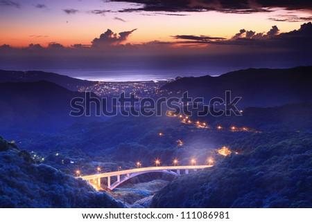 Beautiful night scene of Coastline in Taipei - stock photo
