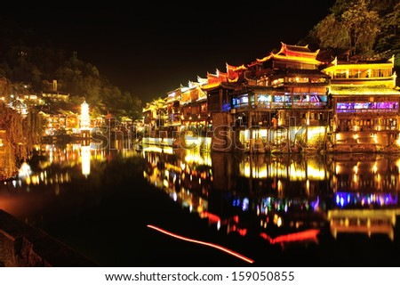beautiful night scene  of Fenghuang (Phoenix) ancient town,Hunan province, China  - stock photo