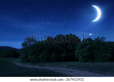 Beautiful night sky with the moon and stars. Spring in Crimea - stock photo