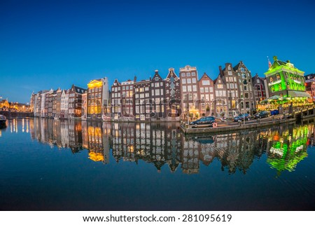 Beautiful night skyline of Amsterdam. City homes along canal. - stock photo