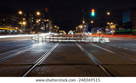 Beautiful night tracks at the intersection - stock photo