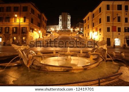 Beautiful night view of Barcaccia Fountain and Spanish Step - stock photo