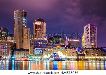 Beautiful night view of Boston Massachusetts skyline and Boston Harbor  - stock photo