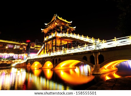 beautiful night view of Fenghuang (Phoenix) ancient town,Hunan province, China - stock photo