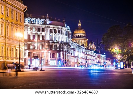 Beautiful night view of Nevsky Prospect and Isaac's Cathedral near Palace Square in Saint Petersburg. Colorful illumination for prominent russian landmark. Saint-Petersburg, Russia - stock photo