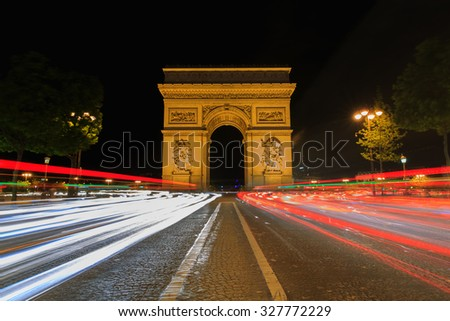 Beautiful night view of the Arc de Triomphe, Paris, France. - stock photo