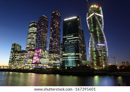 Beautiful night view Skyscrapers City international business center with Moskva river, Russia Moscow - stock photo