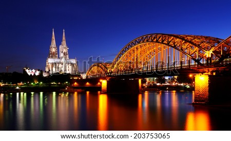 Beautiful night with hohenzollern bridge and cathedral in Cologne, Germany - stock photo
