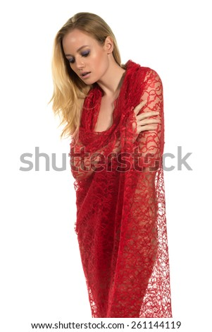 Beautiful nude blonde woman wrapped in red cloth - stock photo
