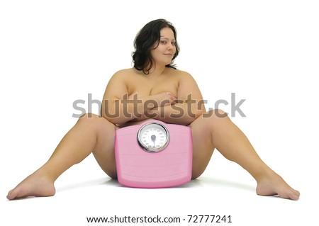 Beautiful nude large girl with weight scale isolated in white - stock photo