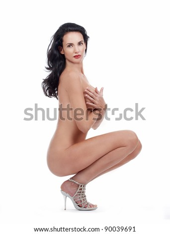 beautiful nude woman with dark hair looking at camera - isolated on white - stock photo
