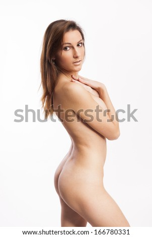 Beautiful nude woman with perfect body on white isolated background - stock photo