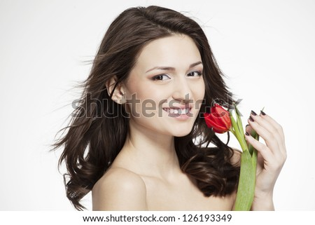 beautiful nude woman with perfect skin and flowers - stock photo