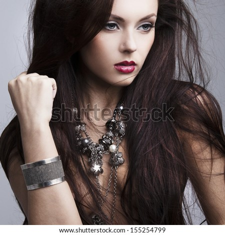 beautiful nude woman with perfect skin and jewelry - stock photo