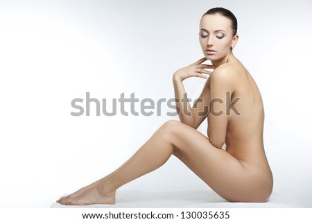 beautiful nude woman with perfect skin on a white background - stock photo