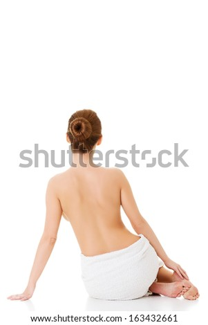 Beautiful nude woman with towel. Isolated on white. - stock photo