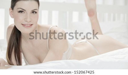 Beautiful nude woman with undressed - stock photo