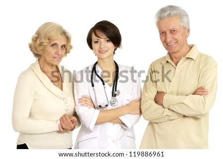 Beautiful nurse with elderly patient on a light background - stock photo