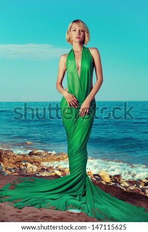 Beautiful nymph on the ocean. Fashion photo - stock photo