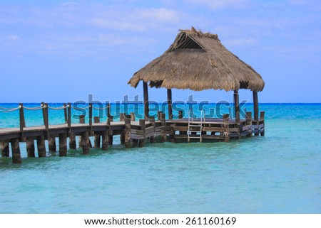 Beautiful ocean dock at a tropical island destination - stock photo