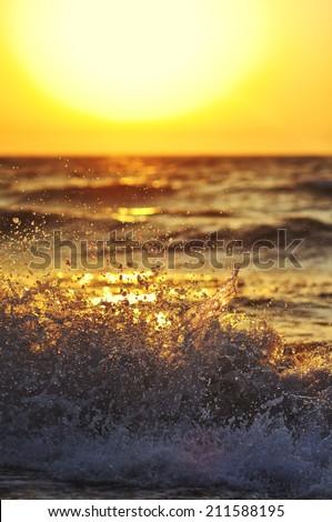 Beautiful ocean surfing shorebreak wave at sunset time - stock photo