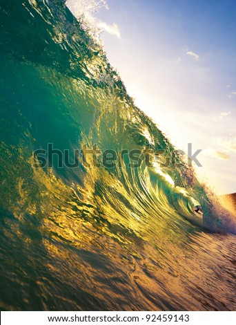 beautiful ocean wave at sunset - stock photo