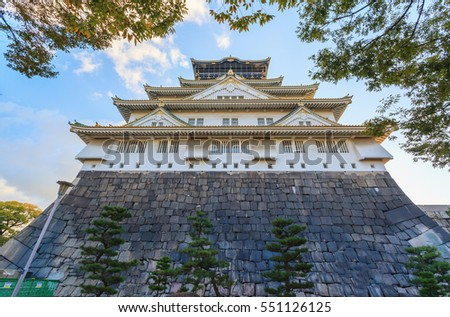Beautiful of Osaka Castle in Osaka city with autumn leaves season in Japan
