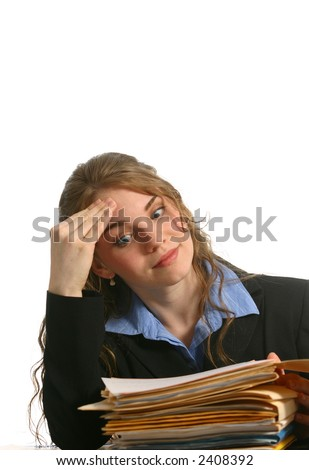 Beautiful office worker with unique expression looking at files - stock photo