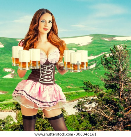 Beautiful oktoberfest young sexy woman wearing a dirndl with six froth beer mugs outdoor on green alpine meadow - stock photo