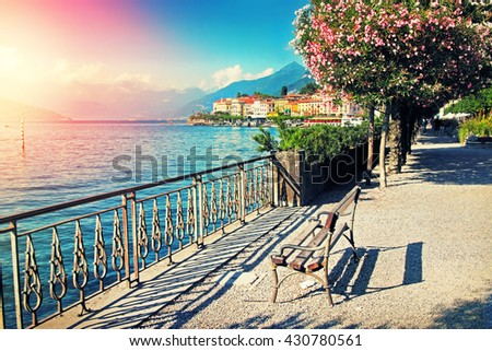 Beautiful old Bellagio city and walkway along Como lake, Italy. Filter applied. - stock photo
