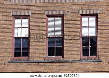 Beautiful old brick wall with windows - stock photo