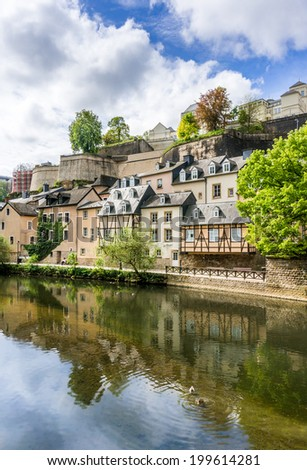 Beautiful old buildings reflected in the water in Grund, Luxembourg City - stock photo