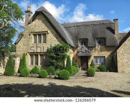 Beautiful old cottage with thatched roof in the village of Chipping Campden, Cotswold, United Kingdom. - stock photo