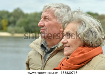 beautiful old couple resting together in autumn