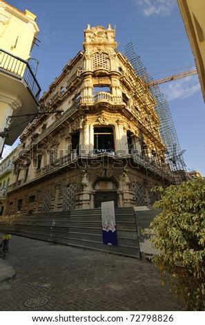 Beautiful Old Havana edifice in Plaza Vieja being restored - stock photo