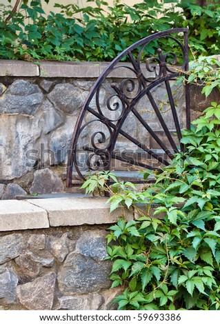 Beautiful old iron lattice in a garden - stock photo