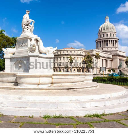 Beautiful old marble fountain with the Capitol of Havana in the background - stock photo