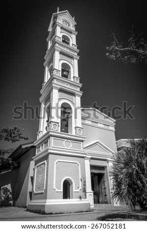 Beautiful old Spanish chapel and bell tower near Playa del Carmen, Mexico - stock photo