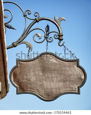beautiful old store sign in front of sky - stock photo