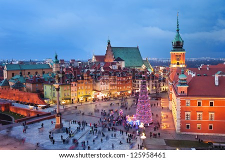 Beautiful Old Town of Warsaw in Poland illuminated at evening, during Christmas time. - stock photo