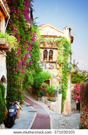 beautiful old town street of Provence at summer day, France, retro toned - stock photo