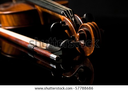 Beautiful old violin on dark background - stock photo