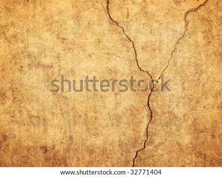 Beautiful old wall with large cracks and texture - stock photo