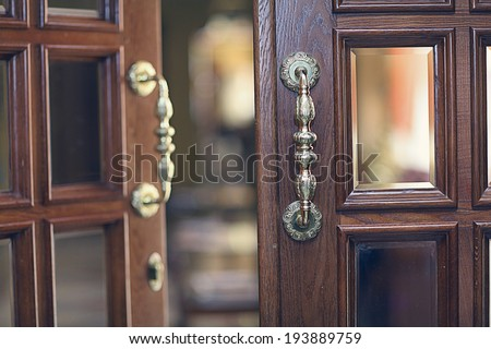 beautiful old wooden door with glass - stock photo