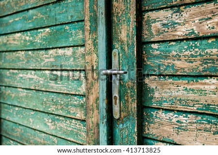 Beautiful old wooden garage plank door with faded paint